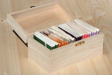 individually: selection of Individually wrapped teabags in wooden box