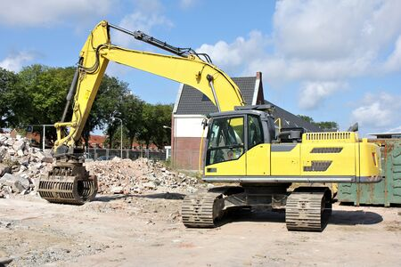 building sector: demolition excavator at building site Stock Photo