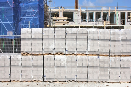 building sector: pallets of bricks at construction site Stock Photo