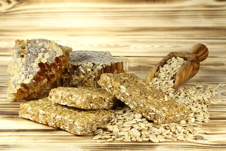 cash crop: granola bars with ingredients on wooden background