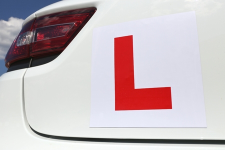 affixed: magnetic British L-plate affixed to the back of a white car Stock Photo