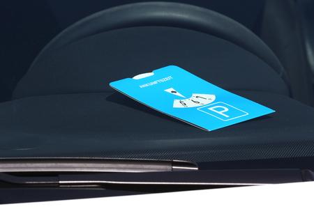 constraint: European standard parking disc on display behind front windshield