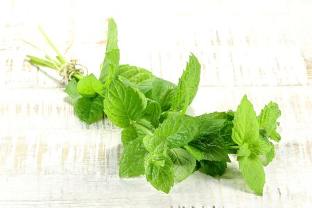 bunch of peppermint on wooden background