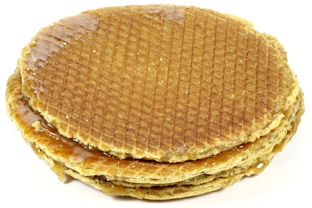 treacle: traditional large dutch syrup waffles isolated on white background