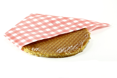 treacle: traditional large dutch syrup waffle isolated on white background