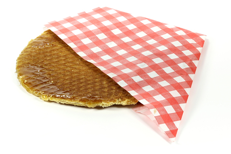 traditional large dutch syrup waffle isolated on white background