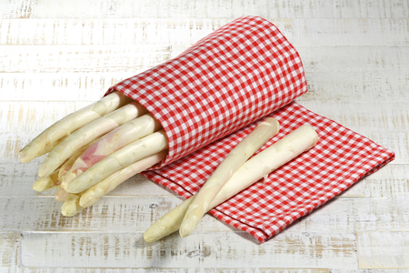 white asparagus: bundle of white asparagus on wooden background Stock Photo