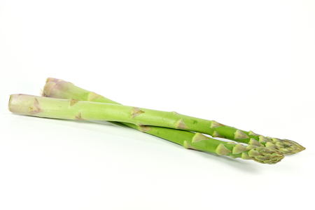mellowness: green asparagus isolated on white background Stock Photo
