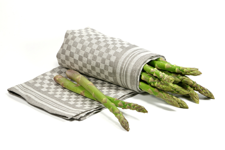 mellowness: bundle of green asparagus isolated on white background