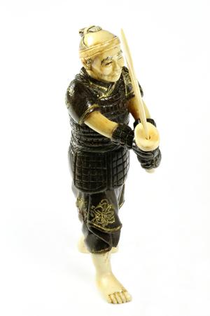 boxwood: antique Japanese netsuke warrior made of ivory and boxwood isolated on white background