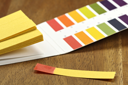 universal indicator paper with acidic testing Stock Photo - 59394596