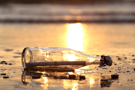 shorelines: message in a bottle stranded on the beach