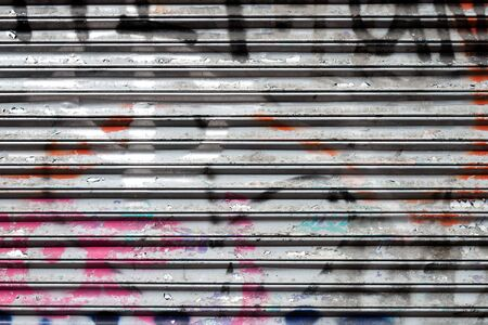spall: closed shutter covered with graffiti for background use