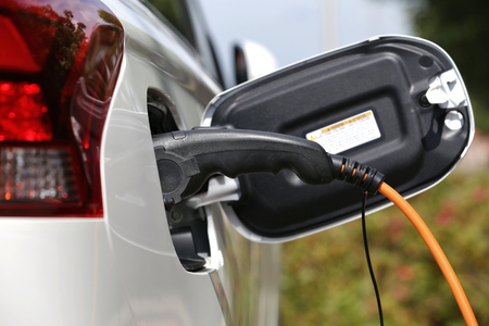 nonpolluting: electric car being charged