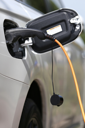 gasoline powered: electric car being charged