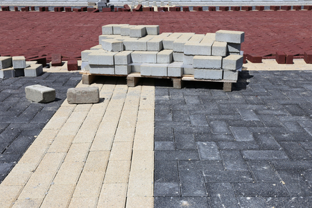housing lot: pallet of cobbles at construction site in residential zone Stock Photo