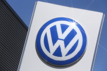 Volkswagen dealership sign in front of the showroom