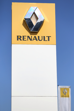 retailing: Renault dealership sign in front of the showroom