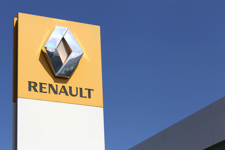 appointed: Renault dealership sign in front of the showroom