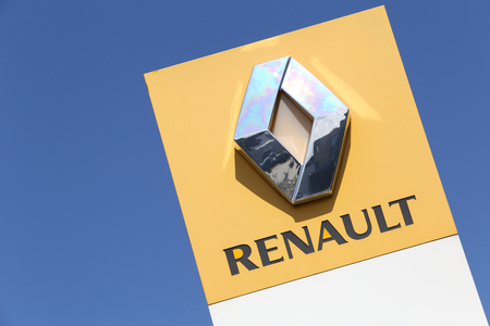 Renault dealership sign in front of the showroom