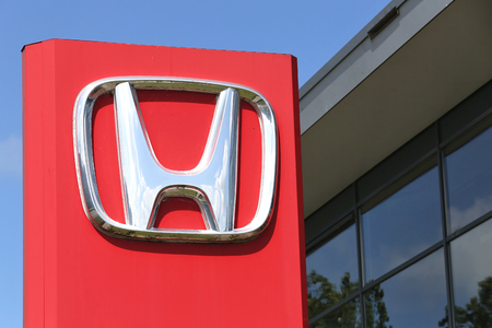 Honda dealership sign in front of the showroom