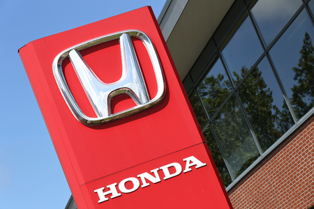 retailing: Honda dealership sign in front of the showroom