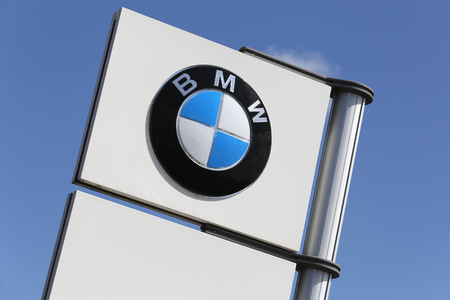 BMW dealership sign in front of the showroom
