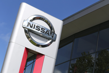appointed: Nissan dealership sign in front of the showroom