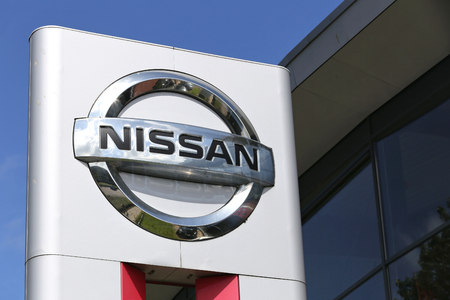 retailing: Nissan dealership sign in front of the showroom