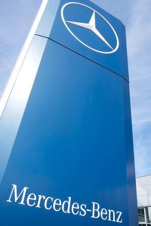 appointed: Mercedes-Benz dealership sign in front of the showroom