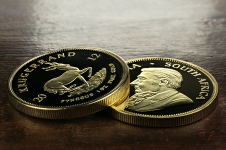 ounce: South African 1 ounce gold bullion coins on wooden background