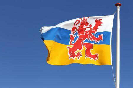 limburg: flag of Dutch province Limburg blowing in the wind