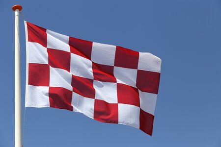 north brabant: flag of Dutch province North Brabant blowing in the wind Stock Photo
