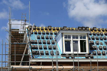 roofing work at new build single-family house
