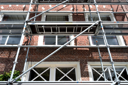 scaffolding at urban building currently under renovation Stock Photo
