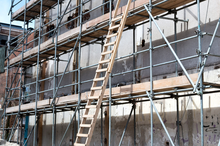 couplers: scaffolding at urban building currently under renovation Stock Photo
