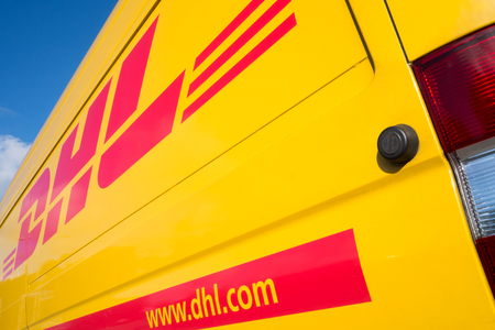 side panel of a DHL delivery van Editorial