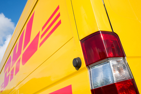 panel van: side panel of a DHL delivery van Editorial