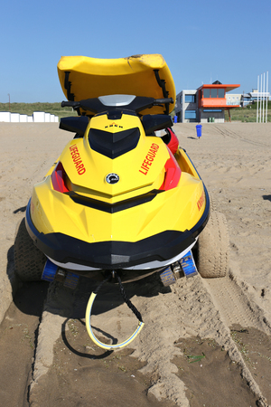 personal watercraft: waterscooter of the Dutch lifeguard association at the beach of Katwijk in front of the guardhouse
