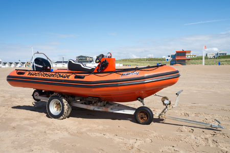 speedboat: speedboat of the Dutch lifeguard association at the beach of Katwijk in front of the guardhouse Editorial