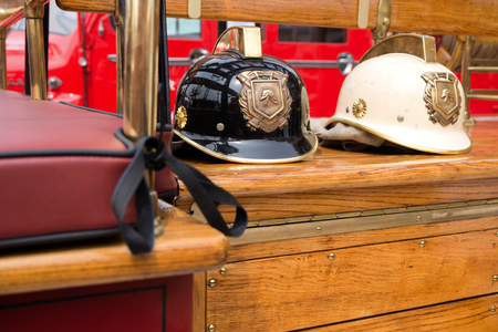 FIRE ENGINE: two old firefighters helmets on board a classic fire engine