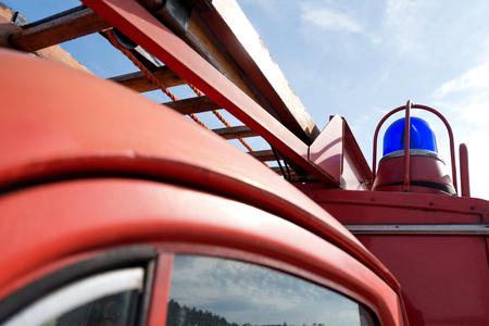emergency vehicle: blue emergency vehicle lighting of a classic fire engine