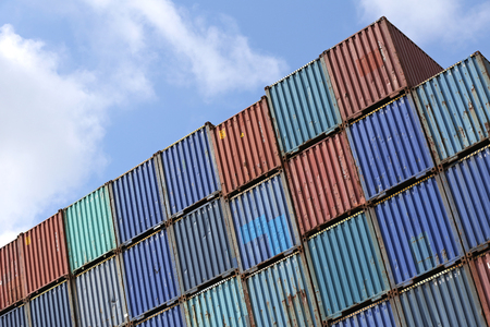 standard steel: Intermodal containers stacked in harbor