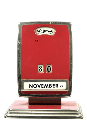 almanac: old perpetual calendar in German language showing 30th of November isolated on white background Stock Photo