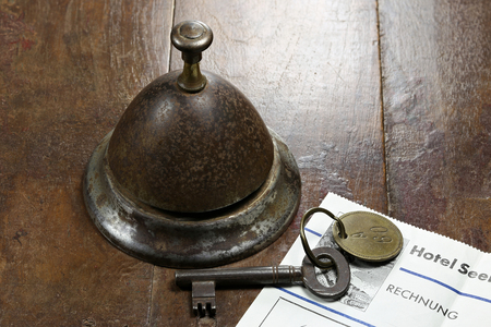 service bell: vintage German hotel bill at counter with room key and service bell