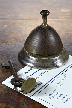 vintage German hotel bill at counter with room key and service bell
