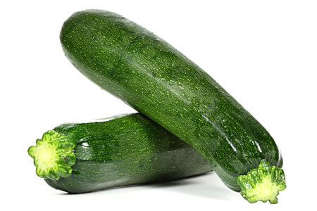 mellowness: zucchinis isolated on white background