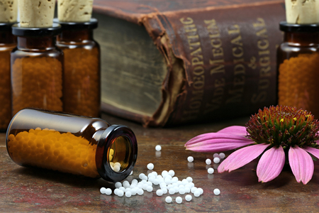 homeopath: homeopathic echinacea pills on wooden background Stock Photo