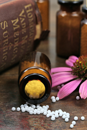 homeopathic echinacea pills on wooden background Stock Photo