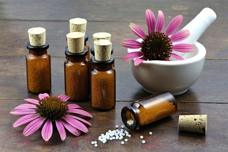 echinacea: homeopathic echinacea pills on wooden background Stock Photo